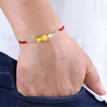 Yellow agate and yellow crystal rakhi in flat woven burgundy thread - FOR AUSTRALIA