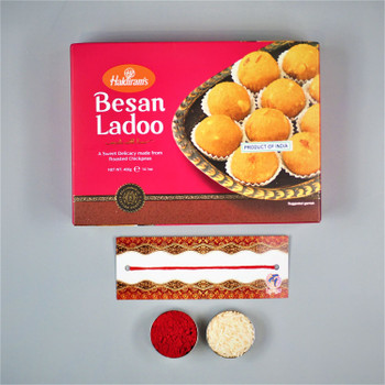 Bhaidooj gifts with besan laddu.