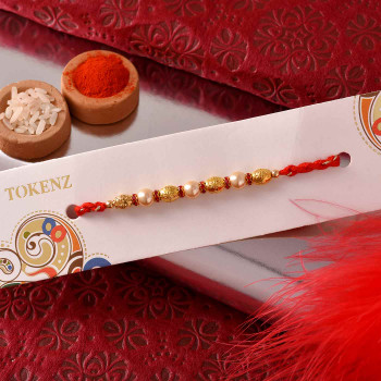 Pearl Rakhi with Pista Roll and Thali