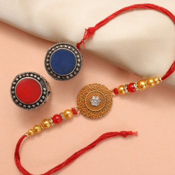 Artistic Rakhi crafted with traditional golden and red beads and woven in premium quality red thread. A combination of art and traditional values.