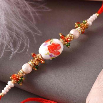 Beautiful Floral Design Pearl Rakhi - For India