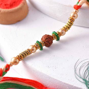 Elegant Rudraksh Rakhi with Golden Beads