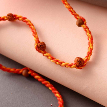 Rudraksh Rakhi Braided in Yellow Orange Thread - For India