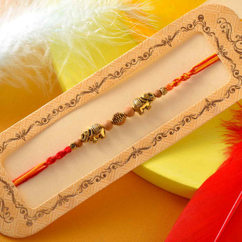 Elephant Designer Rakhi In Red And Orange Thread