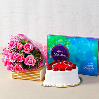 Treat of Strawberry Cake with Pink Roses and Chocolates