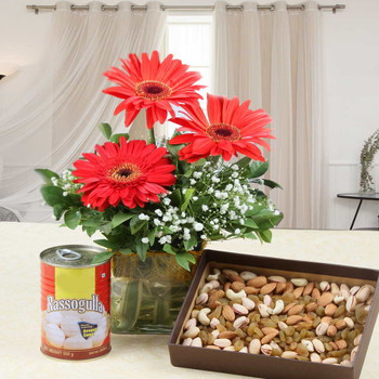 Rasgullas Sweet with Red Gerberas in Vase and Dry Fruits