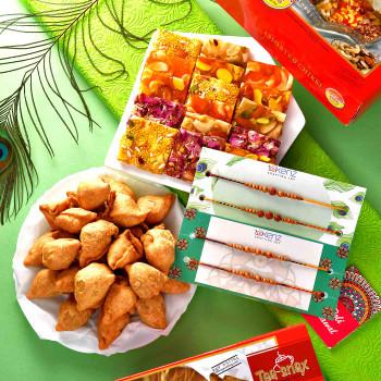 4 Rakhi Set With Assorted Chikki & Mini Samosa - For India