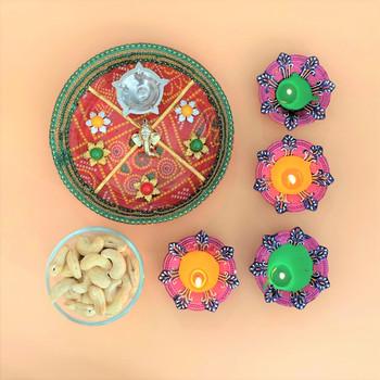 Pooja thali with cashews and Diya
