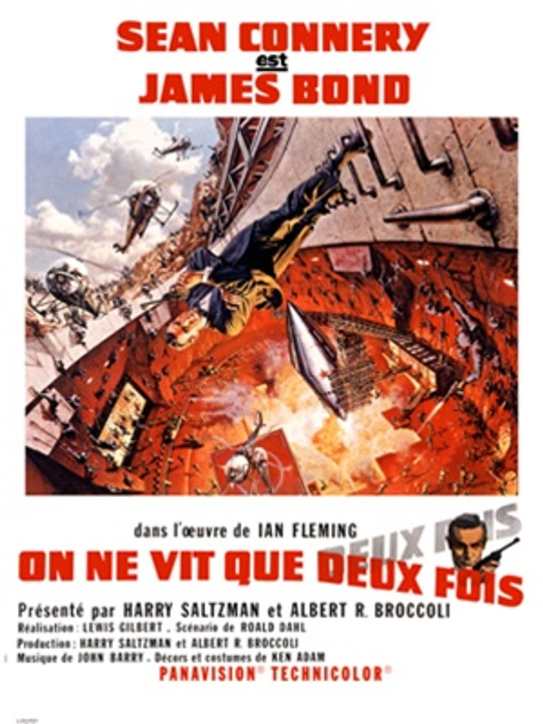 James Bond poster, On Ne Vit Quex Deux Fois 1960 France - Vintage Poster Reproductions. This vertical French theater poster features Agent 007 walking sideways over an exploding silo with helicopters overhead. Giclee Advertising Print. Classic Posters