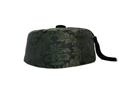 Our olive brocade smoking cap with black lining is sure to keep your head warm and enhance your style.  Topped off with a black velvet button with removable tassel.   Unisex styling.  Available in sizes Small to 3X.  See cap sizechart for best fit.   Dry Clean Only.