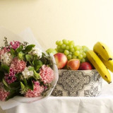 Fruit hamper and flower posy gift basket