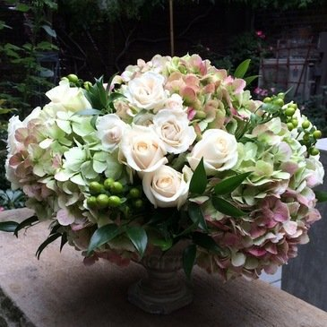 Hydrangea and rose arrangement in a vase
