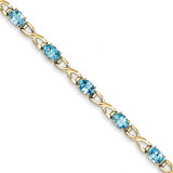 7x5mm Oval Blue Topaz bracelet 14k Gold X951BT