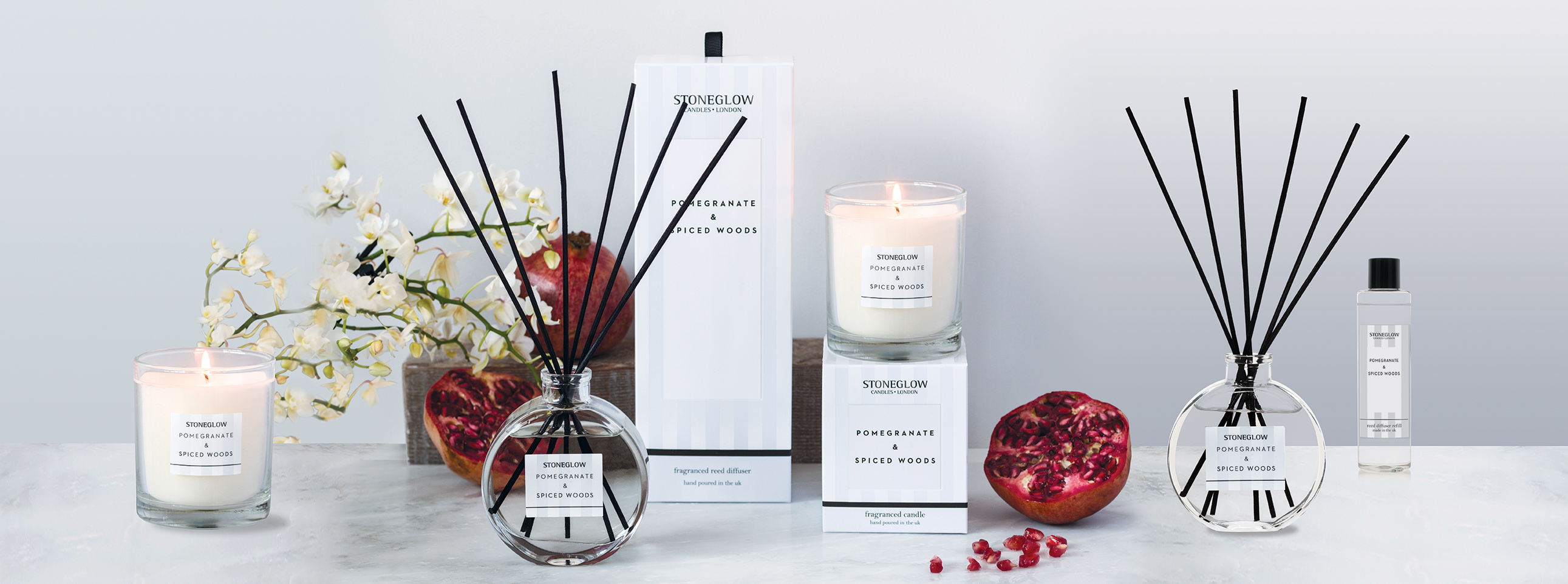 Pomegranate spiced woods candles banner
