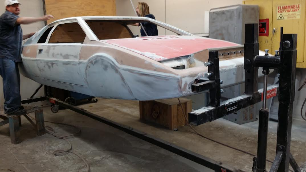 The crew at Rick's Restoration restoring the James Bond Lotus Submarine Car with the Weaver® W-Rotisserie