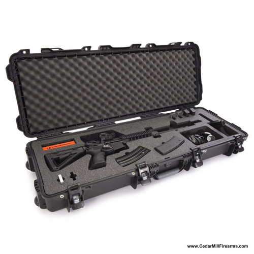 Nanuk 990 Gun Case with Foam for Rifle or AR-15 - Black Pick and pluck foam customized to fit an AR-15, a pistol and extra magazines