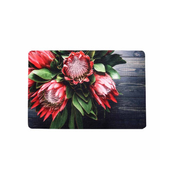 Fynbos Protea on Wood Single Photo of PVC and Felt Placemat. Five Ice Pink Proteas in a bouquet with green leaves on a grey wooden background.
