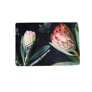 Protea on Dark Wood Single Photo of PVC and Felt placemat.  White protea with leaves and Pink Ice Protea with leaves on dark brown background.