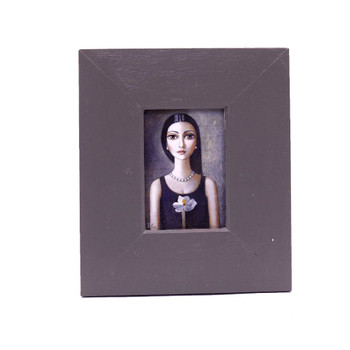 Small Grey Wooden Frame with Print - Black haired lady with black shirt holding off white orchid.
