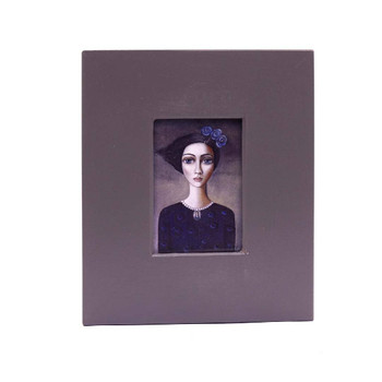 Small Grey Wooden Frame with Print - Short Dark Wind-swept haired lady with blue and purple shirt with purple flowers in hair.