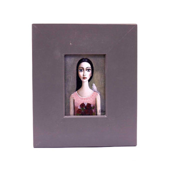 Small Grey Wooden Frame with Print - Dark Long haired lady with pinkish shirt holding a bouquet red roses with white dove on left shoulder on a greyish background.