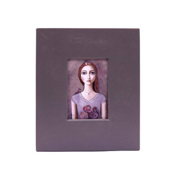 Small Grey Wooden Frame with Print - Auburn Long haired lady with purple shirt holding a bouquet of purple flowers with little bird on right shoulder on a greyish background.