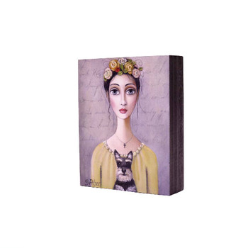 Printed Wooden Block in Grey: Dark haired lady with yellow flowers in her hair, with a yellow shirt holding a Black Scottish terrier on a light brownish grey background.