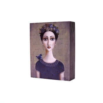 Printed Wooden Block in Grey: Dark haired lady with colorful flowers in hair in a dark blue shirt with small blue bird on her right shoulder on a brownish grey background.