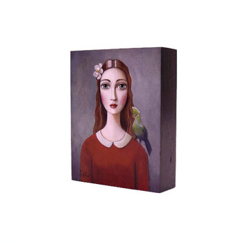 Printed Wooden Block in Grey: Red haired lady red shirt, Knysna Loerie on left shoulder and white flower in hair on dark grey background.