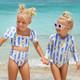 Lifestyle Image of Daisy Cabana Stripe 2PC Puff Sleeve Swimsuit