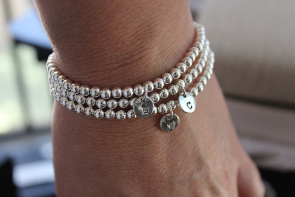 stretch bead bracelet + disc • gold or silver