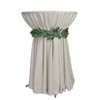 120 inch Round Polyester Tablecloths Ivory on cocktail table