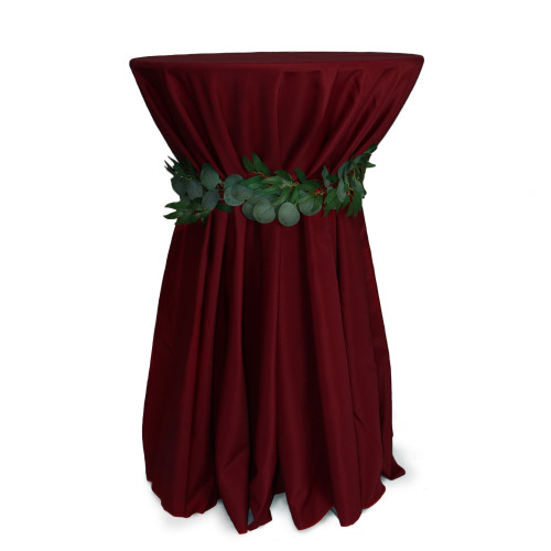 120 Inch Round Polyester Tablecloth Burgundy on cocktail table