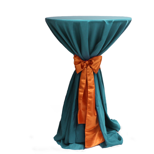 120 Inch Round Polyester Tablecloth Teal on cocktail table