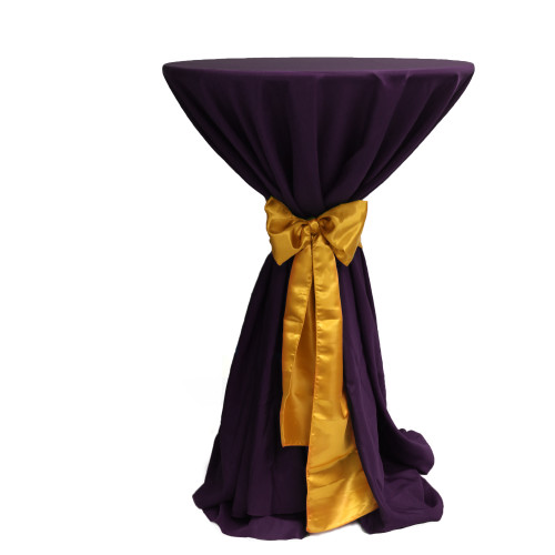 120 Inch Round Polyester Tablecloth Eggplant on cocktail table
