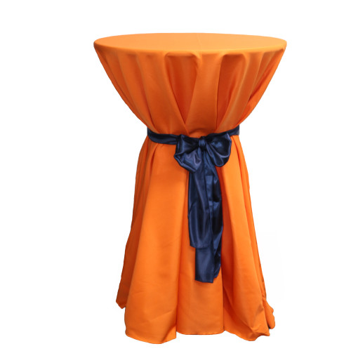 120 inch Round Polyester Tablecloths Orange on cocktail table