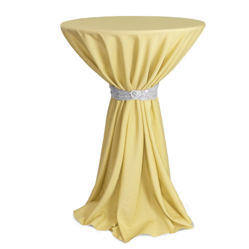 108 inch Round Polyester Tablecloth Pastel Yellow on cocktail table