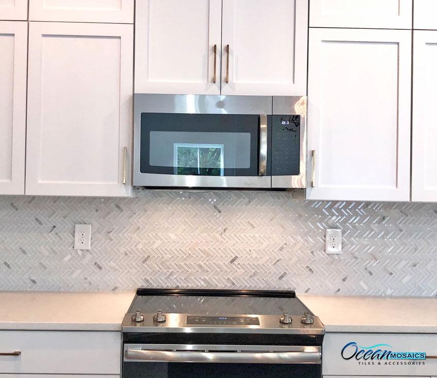 ocean-mosaics-tiles-archery-white-oak-herringbone-kitchen-backsplash.jpg