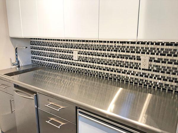 ocean-mosaics-tiles-mont-blanc-marquina-kitchen-pantry.jpg
