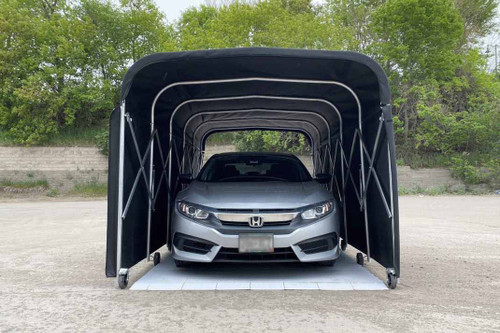 A car inside the portable equipment shelter with flooring.