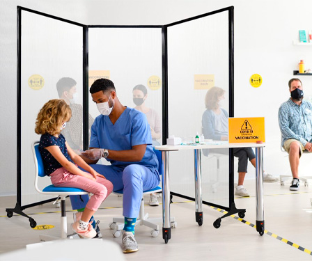 Setup portable vaccination stations using the MediWall Folding Partition.