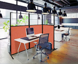 Workstation screens can fold into a private cubicle.