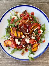 Grilled peach salad with crumbled cheese, toasted pecans & raspberry vinaigrette