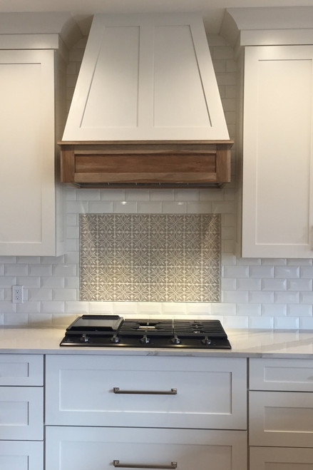 Beautiful White Farmhouse Kitchen with Decorative Tile Backsplash and Wooden Oven Hood