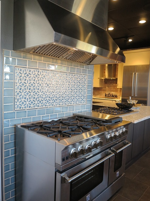 Decorative Handmade Tile Insert On Backsplash Over Oven Range with Subway Tile