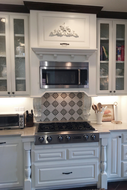 White kitchen with Decorative Tile Niche Over the Oven