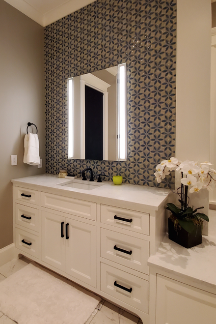 White Master Bathroom with Decorative Handmade Tile Accent Wall