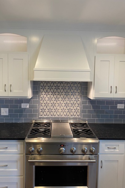White Cottage Kitchen with Beautiful Blue Backsplash