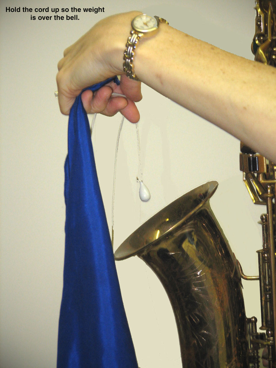 Hodge Alto Sax Silk Swab Step 1 - Hold weight over bell
