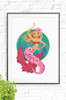 Majestic Mermaid wall art print featuring a happy, blonde mermaid floating in the ocean with a vibrant pink tail and bikini top. With a smiling face, she floats effortless in the sea with her golden hair swimming with the current behind her.